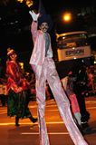 Male performer on stilts. An indian perfomer dressed distinctively walking on stilts during the Chingay Parade Stock Photo