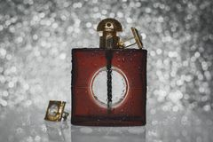 Male perfume with cuff. On gray bokeh Stock Image