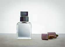 Male perfume and cufflinks Stock Image