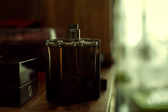 Male perfume. In wooden table Royalty Free Stock Photo