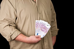 Male person with 500 euro in cash on black Royalty Free Stock Photography