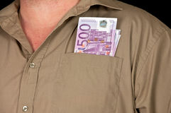 Male person with 500 euro in cash on black Royalty Free Stock Image