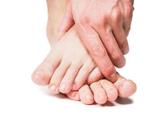 Male person holding onto feet stock images