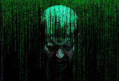 Male person screaming in the security concept matrix of binary code Stock Image