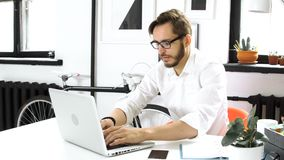 Businessman typing on the laptop keyboard. Male person sit in art workspace and writing financial report use the desktop pc on the table. Guy type strategy and stock video
