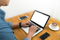 Male person sitting front open laptop computer with blank empty. Screen for your information or content, modern businessman working coffee shop royalty free stock photography