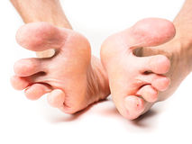 Male person spreading toes Stock Image