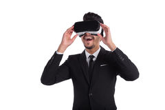 Male person in suit and virtual reality glasses. On white background. 3d vision innovation hi-tech technology Stock Image