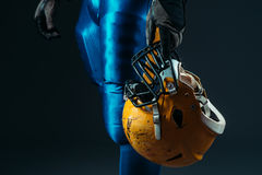 Male person in uniform with football helmet Royalty Free Stock Photography