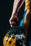 Male person in uniform with football helmet Stock Photography
