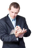 Male personal assistant setting appointments Royalty Free Stock Photo