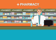 Male pharmacist at the counter in a pharmacy shop.2 Stock Photos