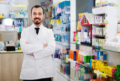 Male pharmacist demonstrating assortment of drugs Stock Photography