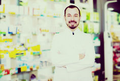 Male pharmacist displaying assortment of drugs Stock Photography