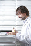Male pharmacist at the drawers Stock Photography