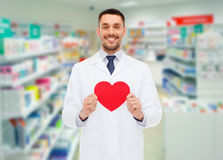 Male pharmacist with heart at drugstore Stock Photos