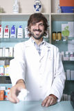 Male pharmacist and medicaments Stock Image
