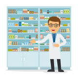 Male pharmacist on medicine background Royalty Free Stock Images