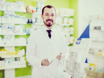 Male pharmacist offering right drug royalty free stock image