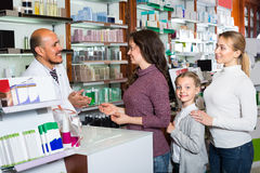Male pharmacist in pharmacy Royalty Free Stock Images
