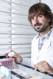 Male pharmacist at the pharmacy store Royalty Free Stock Photography