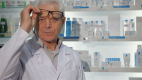 Male pharmacist posing at the drugstore stock video footage