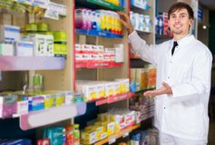 Male pharmacist posing in drugstore stock photos