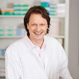Male Pharmacist Smiling In Pharmacy Stock Photos