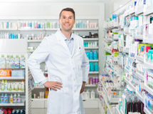 Male Pharmacist Standing With Hands On Hip In Royalty Free Stock Photos