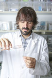 Male pharmacist and test tubes Stock Photography