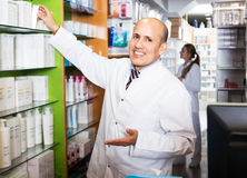 Male pharmacist working in farmacy Stock Image