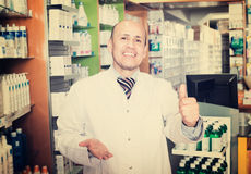 Male pharmacist working in farmacy Royalty Free Stock Image