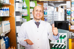 Male pharmacist working in farmacy Stock Photos