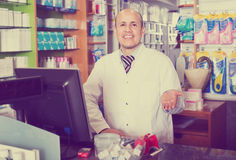 Male pharmacist working in farmacy Stock Photo