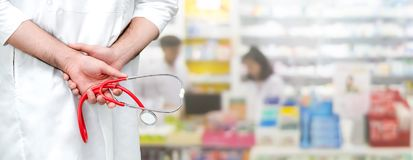 Male pharmacist working at the pharmacy. Young male pharmacist working at the pharmacy. Medical healthcare and pharmaceutical service stock photo