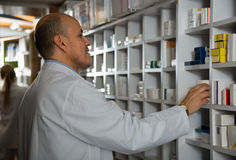 Male pharmacists working in farmacy Royalty Free Stock Photo