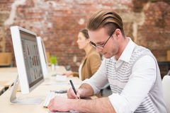 Male photo editor using digitizer in office Royalty Free Stock Photos