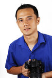 Male Photographer. An Asian male photographer smiling as he holds a cool DSLR camera Stock Photography