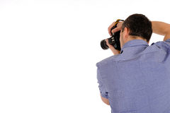 Male photographer from back taking picture Royalty Free Stock Photos