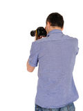 Male photographer from back taking picture Royalty Free Stock Images