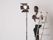 Male Photographer With Camera In Studio Royalty Free Stock Photography