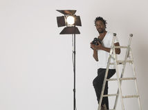 Male Photographer With Camera In Studio royalty free stock images