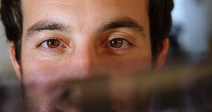 Male photographer checking camera filmstrip 4k. Male photographer checking camera filmstrip in photo studio 4k stock footage