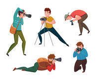 Male Photographer In Different Poses Royalty Free Stock Photos
