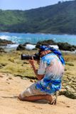 Male photographer with DSLR camera on the beach Stock Images