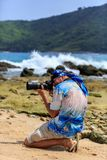 Male photographer with DSLR camera on the beach Stock Photography
