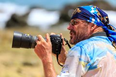 Male photographer with DSLR camera on the beach Royalty Free Stock Image