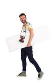 Male photographer with empty sigh board walking over white background Royalty Free Stock Photography