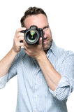 Male photographer focusing an image Royalty Free Stock Photo