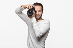 Male photographer focusing an image Stock Images
